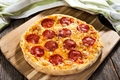 Pepperoni pizza on rustic background - PhotoDune Item for Sale