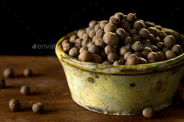 Allspice on rustic background - Stock Photo - Images