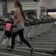 Woman Walking on Treadmill in Gym - VideoHive Item for Sale