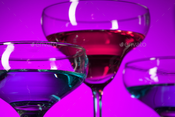 Three wine glasses standing on the table at studio - Stock Photo - Images