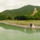 Aerial View Loving Couple on the Background of the River and Mountains. Aerial Photography - VideoHive Item for Sale