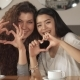 Two Girls Gesture Hearts at the Cafe - VideoHive Item for Sale
