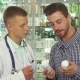 Doctor Consulting Patient About Two Drugs - VideoHive Item for Sale