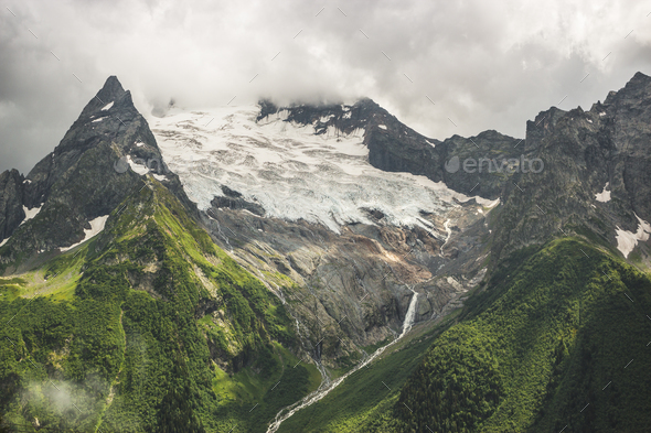 Mountains With Green Grass And Stormy Sky  - Stock Photo - Images