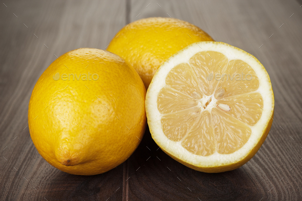 Fresh Lemons On The Wooden Table  - Stock Photo - Images