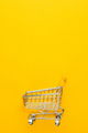Shopping Trolley On Yellow Background  - PhotoDune Item for Sale