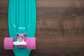 Mini cruiser board on wooden background - PhotoDune Item for Sale