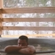 A Man Is Bathing in the Cast Iron Vat with Mineral Water and Turned Off the Tap with Cold Water. - VideoHive Item for Sale