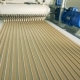Top View of Straight Rows of Sweet Cream Moving Further Along the Conveyor - VideoHive Item for Sale