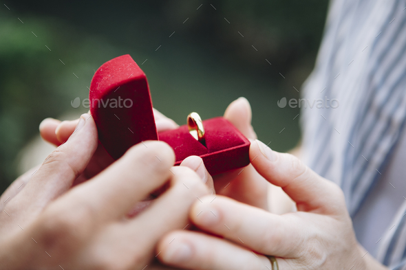 Man proposing to his girlfriend - Stock Photo - Images