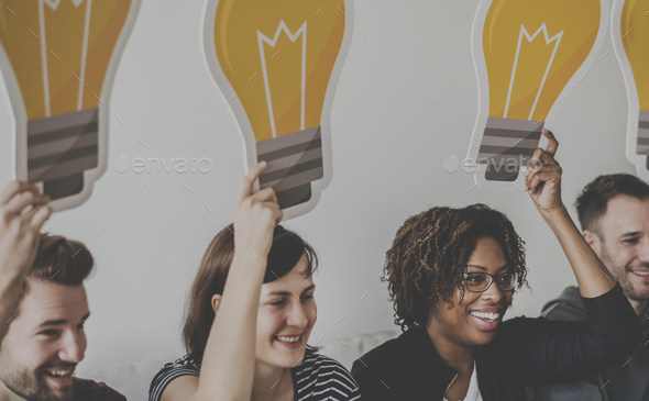 Peopl with lightbulb icon - Stock Photo - Images