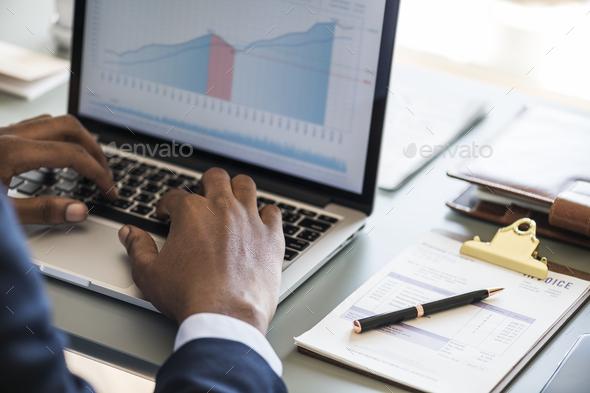 Black businessman using computer laptop - Stock Photo - Images