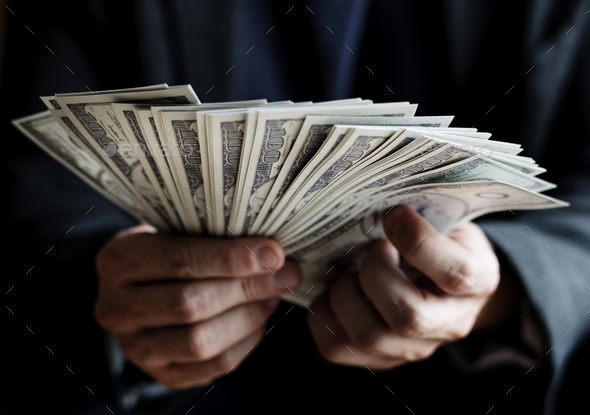 Closeup of hands holding cash - Stock Photo - Images