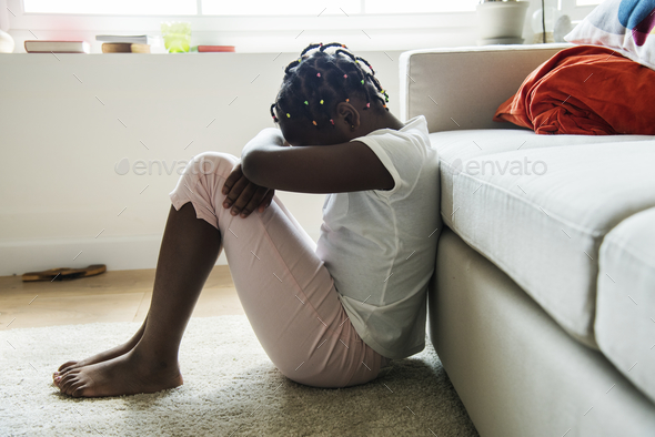 Black girl with sadness emotion - Stock Photo - Images
