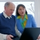 Internet Technology, Senior Couple Talk in Skype Using a Laptop Indoors - VideoHive Item for Sale