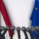 Flags of the Netherlands and the European Union at International Press Conference - VideoHive Item for Sale