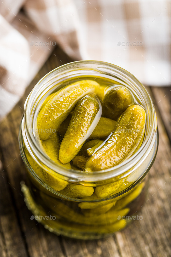 Pickles. Preserved cucumbers. - Stock Photo - Images