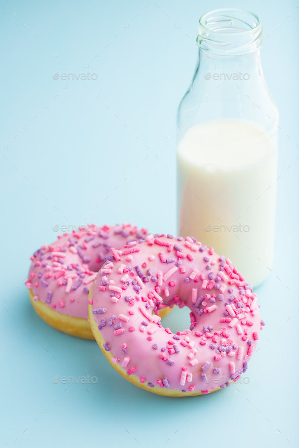 Two pink donuts and milk. - Stock Photo - Images