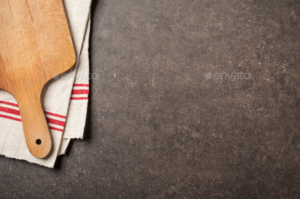 Vintage cutting board and linen towel on rustic table - Stock Photo - Images