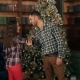 Happy Couple Having Fun Near the Christmas Tree - VideoHive Item for Sale