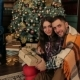 Portrait of Couple with a Gift Near Christmas Tree - VideoHive Item for Sale