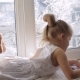 Little Girl Draws Pictures Lying on the Window Sill. Sunny Winter Morning - VideoHive Item for Sale