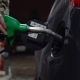 Woman Fills Petrol Into Her Car at a Gas Station in Winter - VideoHive Item for Sale