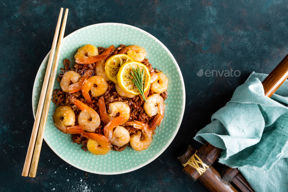 Prawns roasted on gril and rice - Stock Photo - Images