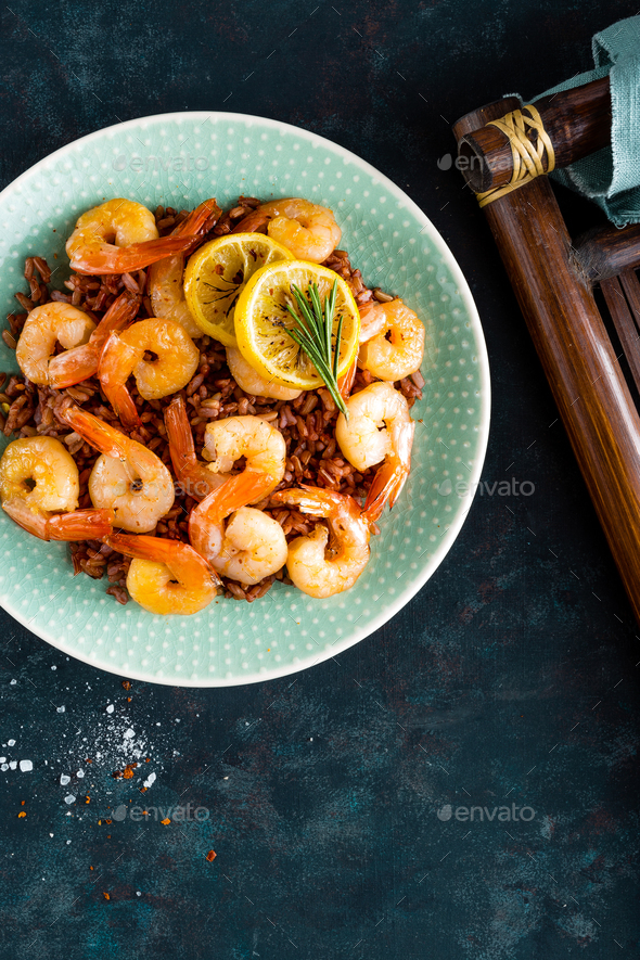 Prawns roasted on grill and rice - Stock Photo - Images