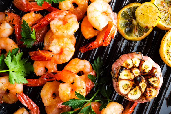 Prawns roasted on grill frying pan - Stock Photo - Images