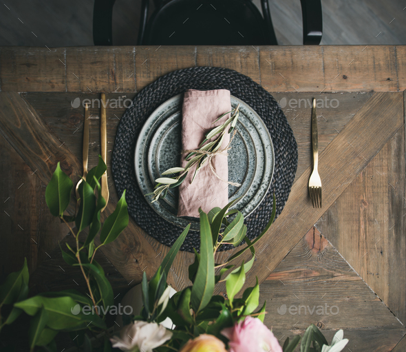 Flat-lay of Spring Easter Table setting over vintage wooden background - Stock Photo - Images