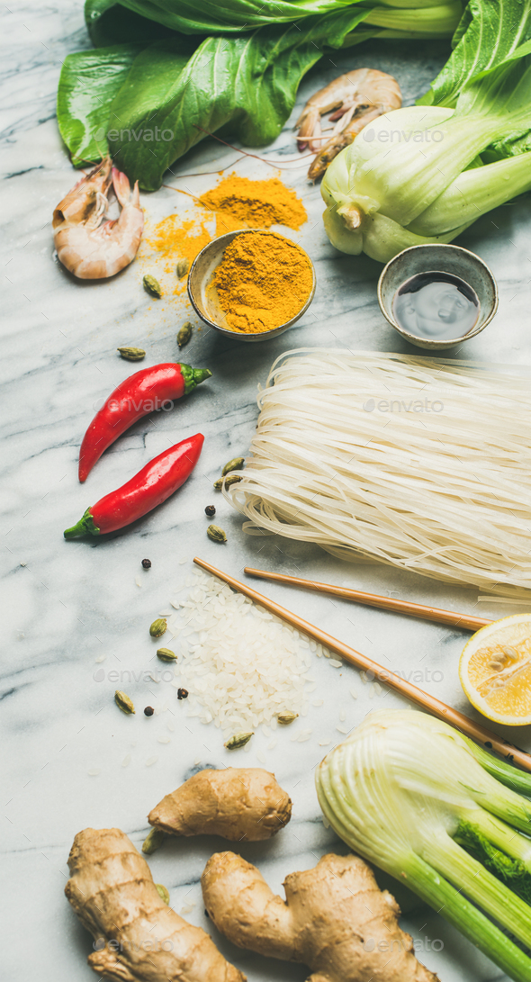 Asian cuisine ingredients over grey marble background - Stock Photo - Images