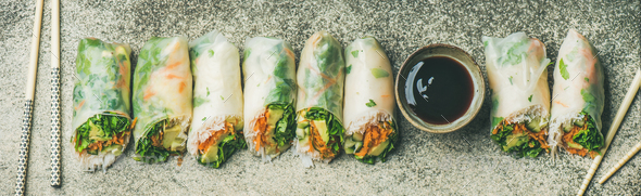 Flat-lay of vegan spring, summer rice paper rolls, wide composition - Stock Photo - Images
