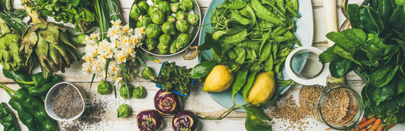 Spring healthy vegan food cooking ingredients, top view, wide composition - Stock Photo - Images