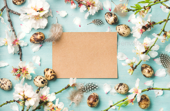 Easter background with eggs and almond flowers, paper in center - Stock Photo - Images