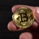 Golden Bitcoin in the Hands - VideoHive Item for Sale
