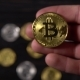 Golden Bitcoin in a Man's Hand. - VideoHive Item for Sale