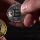 Bitcoins Exchange Between Men and Woman Hand - VideoHive Item for Sale
