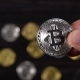 Silver Bitcoin in the Hands of Man At The Backgroundof Other Bitcoins - VideoHive Item for Sale