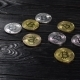 Golden and Silver Bitcoins. Coins of Cryptocurrency on Black Table. - VideoHive Item for Sale