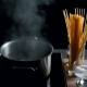 Preparing Water for Spaghetti in Pan on Electric Stove in the Kitchen - VideoHive Item for Sale