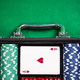 Suitcase with poker chips on poker table - PhotoDune Item for Sale