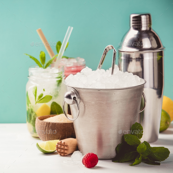 Metal ice bucket and fresh cocktails - Stock Photo - Images