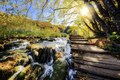 Waterfalls and pontoon in the sunshine in Plitvice National Park - PhotoDune Item for Sale