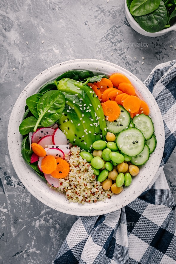 Vegan Buddha bowl salad with spinach, quinoa, roasted chickpeas, grilled chicken, avocado - Stock Photo - Images