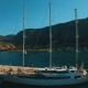 A Large Yacht Stands at the Pier in the Bay Kotor, Montenegro - VideoHive Item for Sale