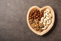 Assorted nuts in heart shaped bowl - PhotoDune Item for Sale