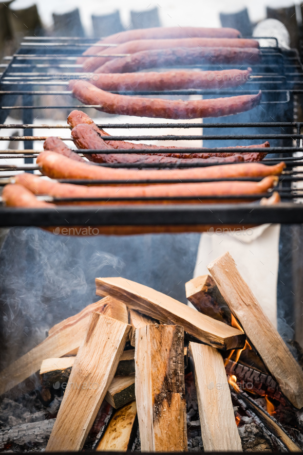 Pork and beef sausages being grilled - Stock Photo - Images