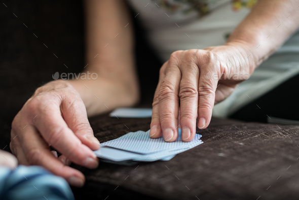 Woman playing cards - Stock Photo - Images