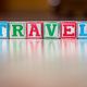 Toy letter blocks spelling the word travel - PhotoDune Item for Sale